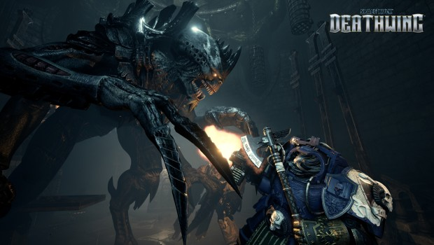 Space Hulk: Deathwing screenshot featuring a giant genestealer fighting a Space Marine