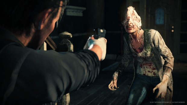 The Evil Within 2 screenshot of a monster with a melted head
