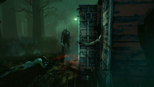 Dead by Daylight screenshot showing a survivor hiding from the monster