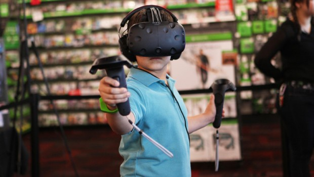 A kid playing with the HTC Vive headset
