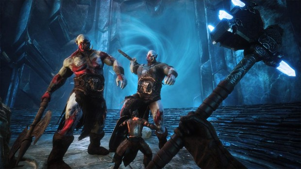 Conan Exiles The Frozen North screenshot of a battle against giants