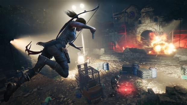 Shadow of the Tomb Raider screenshot of Lara jumping into action with her dagger