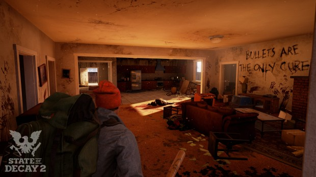 State of Decay 2 screenshot of a ruined house and writing on the wall