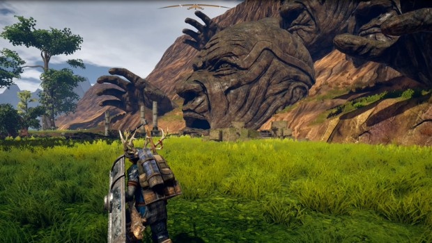Outward screenshot of a giant head carved into the mountain