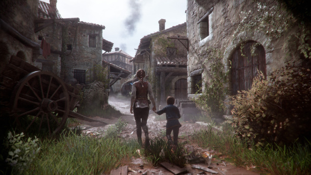 A Plague Tale: Innocence screenshot of our characters and a completely ruined village